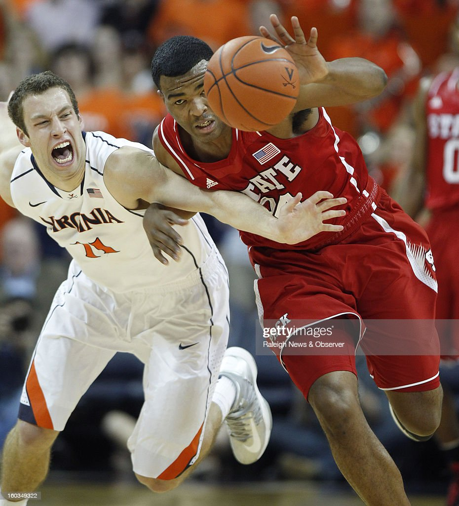 Virginia's Evan Nolte (11) fouls N.C. State's T.J. Warren (24) as they chase a loose ball during the first half at John Paul Jones Arena in Charlottesville, Virginia, Tuesday, January 29, 2013.