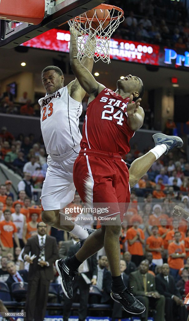 Virginia's Justin Anderson (23) blocks the shot of N.C. State's T.J. Warren (24) during the second half at John Paul Jones Arena in Charlottesville, Virginia, Tuesday, January 29, 2013. The Virginia Cavaliers defeated the North Carolina Wolfpack, 58-55.