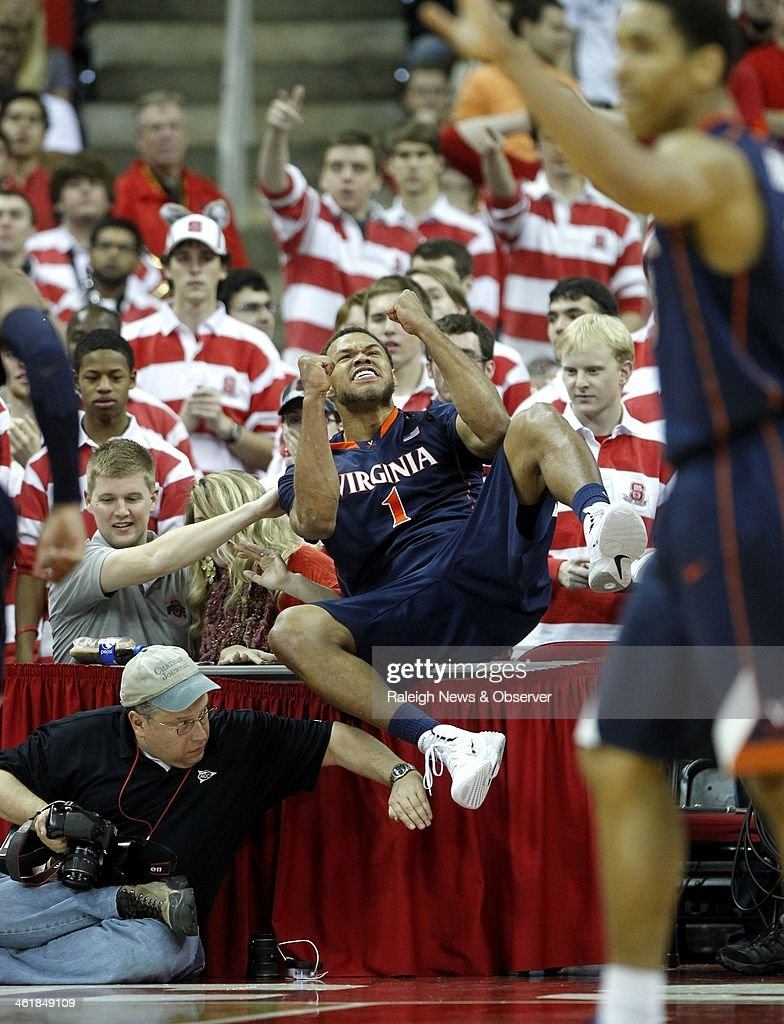 Virginia's Justin Anderson (1) celebrates after saving the ball from going out of the bounds during the second half against North Carolina State at PNC Arena in Raleigh, N.C., on Saturday, Jan. 11, 2014. Virginia rolled, 76-45.