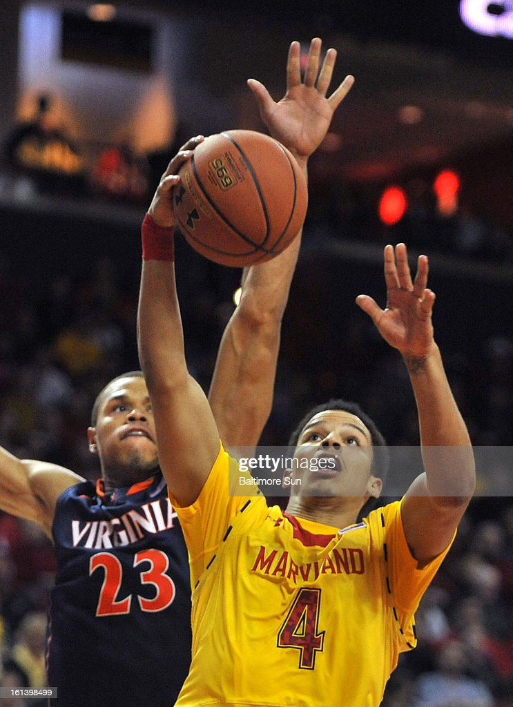 Virginia's Justin Anderson tries to stop Maryland's Seth Allen from scoring during a men's college basketball game in College Park, Maryland, Sunday, February 10, 2013. Virginia won, 80-69.