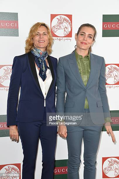 Virginie CouperieEiffel and Charlotte Casiraghi attend the Paris Eiffel Jumping presented by Gucci at ChampdeMars on July 6 2014 in Paris France