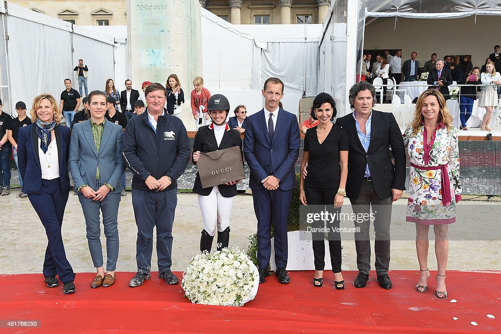 Virginie Couperie-Eiffel, Charlotte Casiraghi, Jan Tops, Robert Triefus, Rachida Dati, Christophe Bonnat and Coco Couperie Eiffel pose with Winner of the 'Gucci Gold Cup Paris Eiffel Jumping Table A against the clock with jump-off ' (C) Reed Kessler (3rd rank) during the Paris Eiffel Jumping presented by Gucci at Champ-de-Mars on July 6, 2014 in Paris, France.