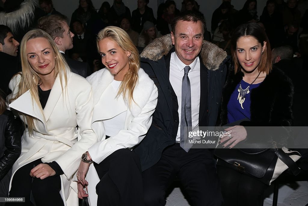 Virginie Courtin, Claire Courtin, their uncle and Prisca Courtin attend the Mugler Men Autumn / Winter 2013 show as part of Paris Fashion Week on January 16, 2013 in Paris, France.