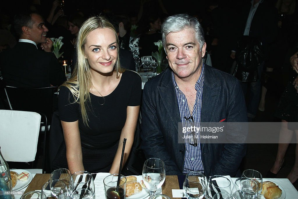 Virginie Courtin- Clarens and Tim Blanks attend the Glamour dinner for Patrick Demarchelier as part of the Paris Fashion Week Womenswear Spring/Summer 2014 at Monsieur Bleu restaurant on September 29, 2013 in Paris, France.