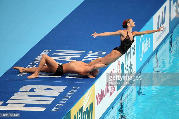 Virginie Dedieu and Benoit Beaufils of France compete in the Mixed Duet Free Synchronised Swimming Preliminary on day four of the 16th FINA World...
