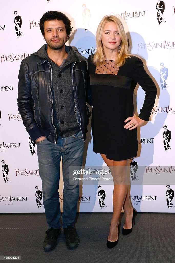 Virginie Efira and her companion Mabrouk El Mechri attend the 'Yves Saint Laurent' Paris movie Premiere at Cinema UGC Normandie on December 19, 2013 in Paris, France.