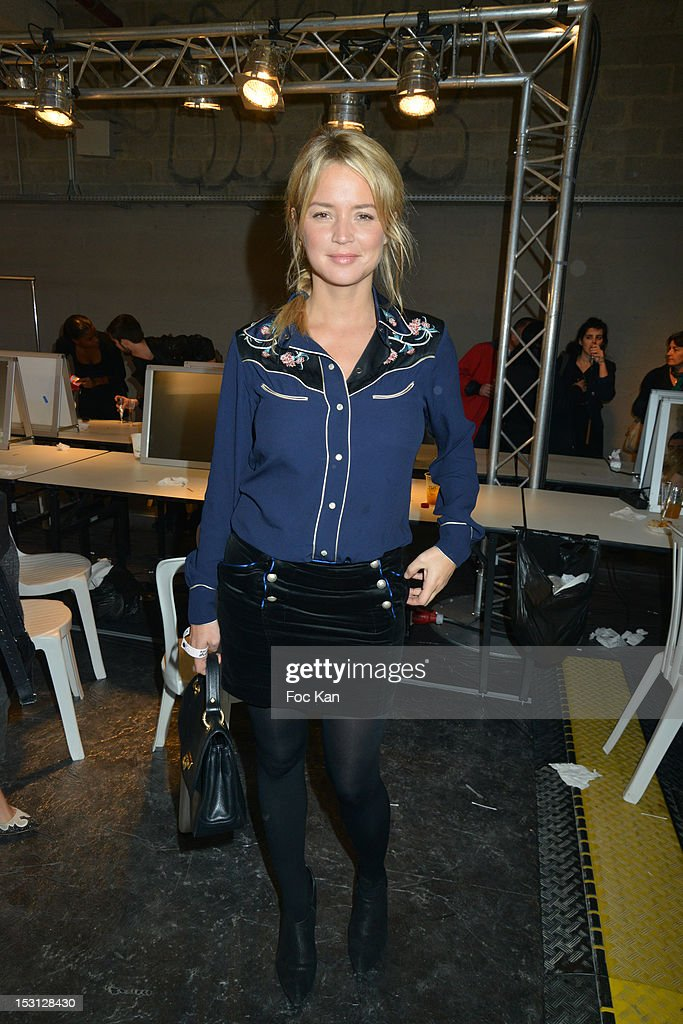 Virginie Efira poses during the John Galliano: Front Row - Paris Fashion Week Womenswear Spring / Summer 2013 at Docks en Seine on September 30, 2012 in Paris, France.