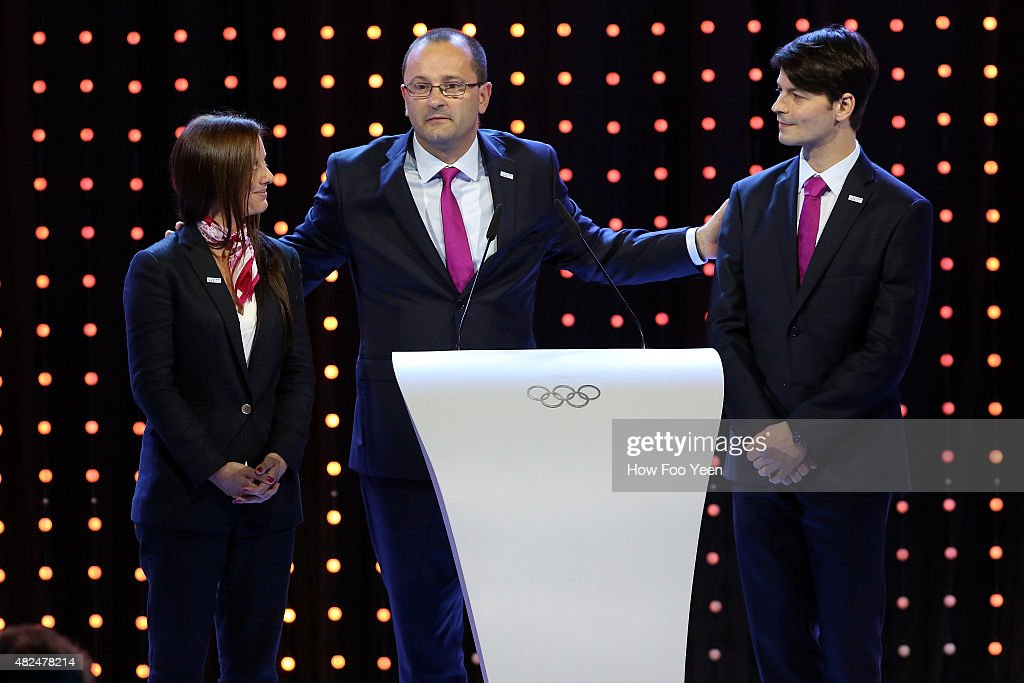 <a gi-track='captionPersonalityLinkClicked' href=/galleries/search?phrase=Virginie+Faivre&family=editorial&specificpeople=786060 ng-click='$event.stopPropagation()'>Virginie Faivre</a>, Patrick Baumann and <a gi-track='captionPersonalityLinkClicked' href=/galleries/search?phrase=Stephane+Lambiel&family=editorial&specificpeople=247248 ng-click='$event.stopPropagation()'>Stephane Lambiel</a> of Lausanne, Switzerland speaks at the presentation during the 128th IOC Session on July 31, 2015 in Kuala Lumpur, Malaysia.