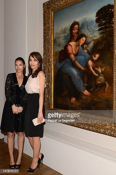 Virginie Ledoyen and Dolores Chaplin pose in front of 'The Saint Anne' Leonardo Da Vinci's Ultimate Masterpiece at Musee du Louvre on March 27 2012...