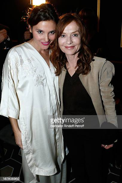 Virginie Ledoyen and Isabelle Huppert attend the HM Fashion Show Fall/Winter 2013 ReadytoWear after party as part of Paris Fashion Week on February...
