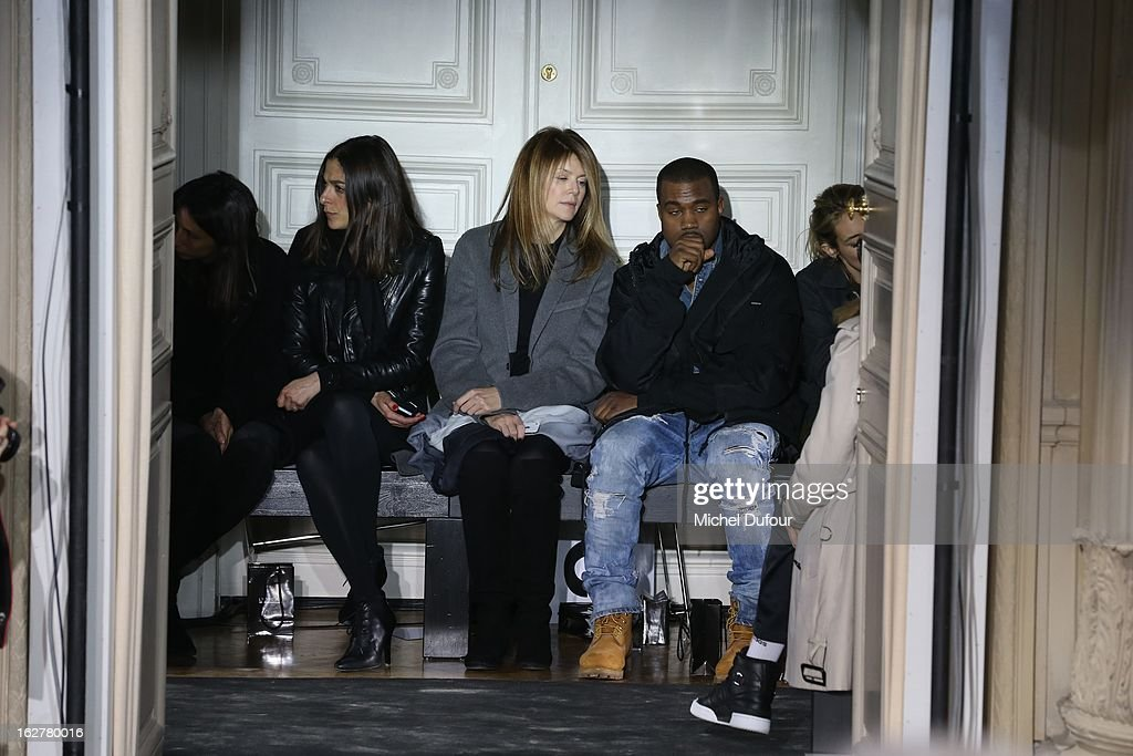 Virginie Mouzin and <a gi-track='captionPersonalityLinkClicked' href=/galleries/search?phrase=Kanye+West+-+M%C3%BAsico&family=editorial&specificpeople=201803 ng-click='$event.stopPropagation()'>Kanye West</a> attend the Anthony Vaccarello Fall/Winter 2013 Ready-to-Wear show as part of Paris Fashion Week on February 26, 2013 in Paris, France.