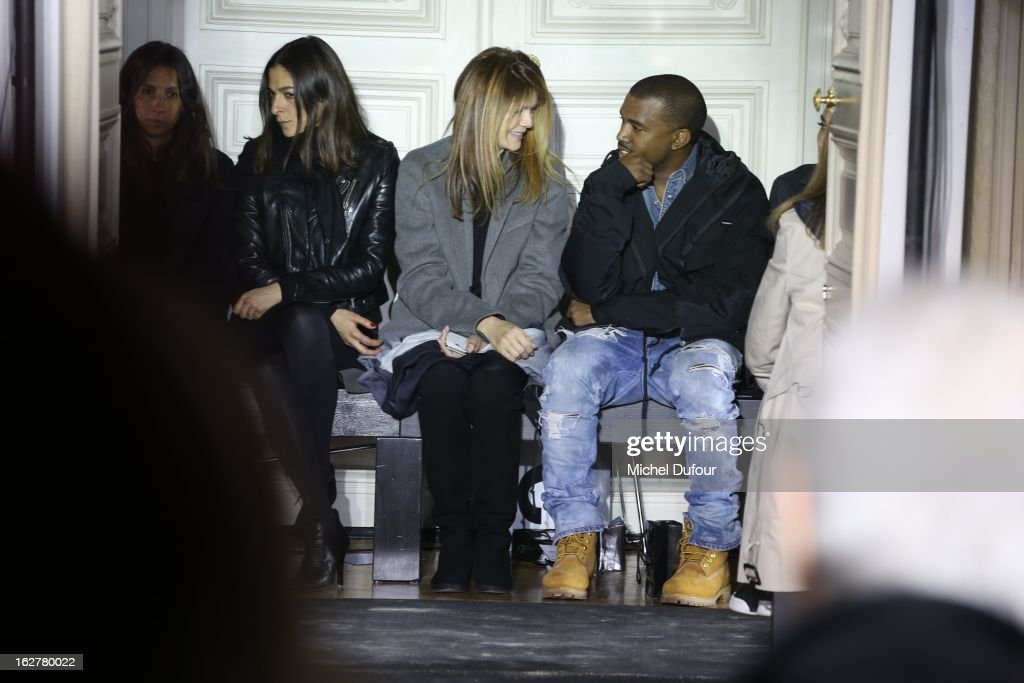 Virginie Mouzin and <a gi-track='captionPersonalityLinkClicked' href=/galleries/search?phrase=Kanye+West+-+Musician&family=editorial&specificpeople=201803 ng-click='$event.stopPropagation()'>Kanye West</a> attend the Anthony Vaccarello Fall/Winter 2013 Ready-to-Wear show as part of Paris Fashion Week on February 26, 2013 in Paris, France.