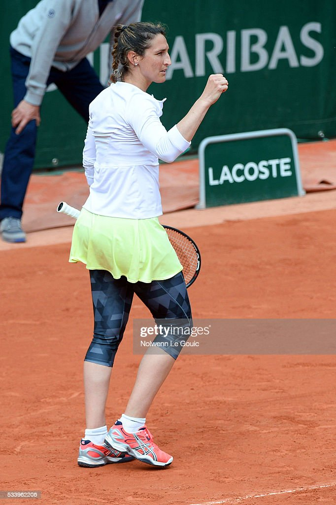 Virginie Razzano celebrates during the Women's Singles first round on day three of the French Open 2016 at Roland Garros on May 24, 2016 in Paris, France.