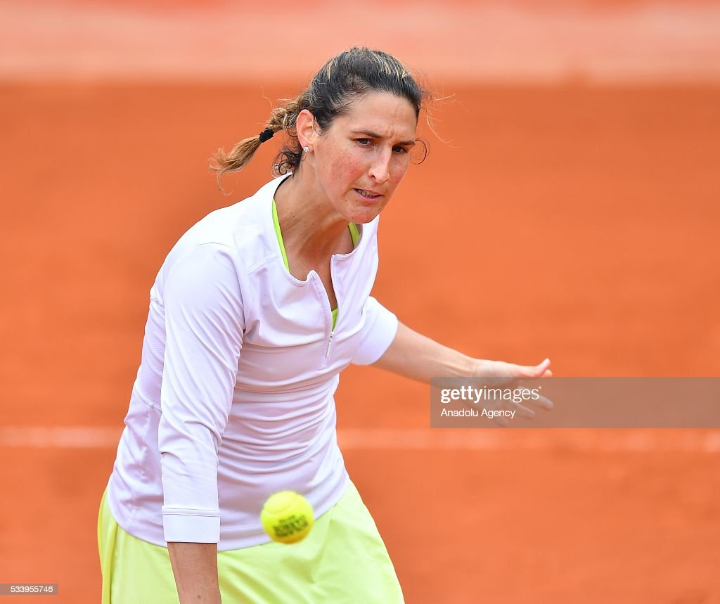 Virginie Razzano (C) of France in an action during women's single first round match against Ipek Soylu of Turkey at the French Open tennis tournament at Roland Garros in Paris, France on May 24, 2016.