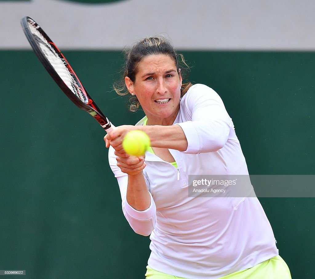 Virginie Razzano (C) of France returns the ball during women's single first round match against Ipek Soylu of Turkey at the French Open tennis tournament at Roland Garros in Paris, France on May 24, 2016.