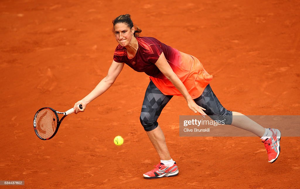 Virginie Razzaro of France hits a backhand during the Ladies Singles second round match against Daria Kasatkina of Russia on day five of the 2016 French Open at Roland Garros on May 26, 2016 in Paris, France.