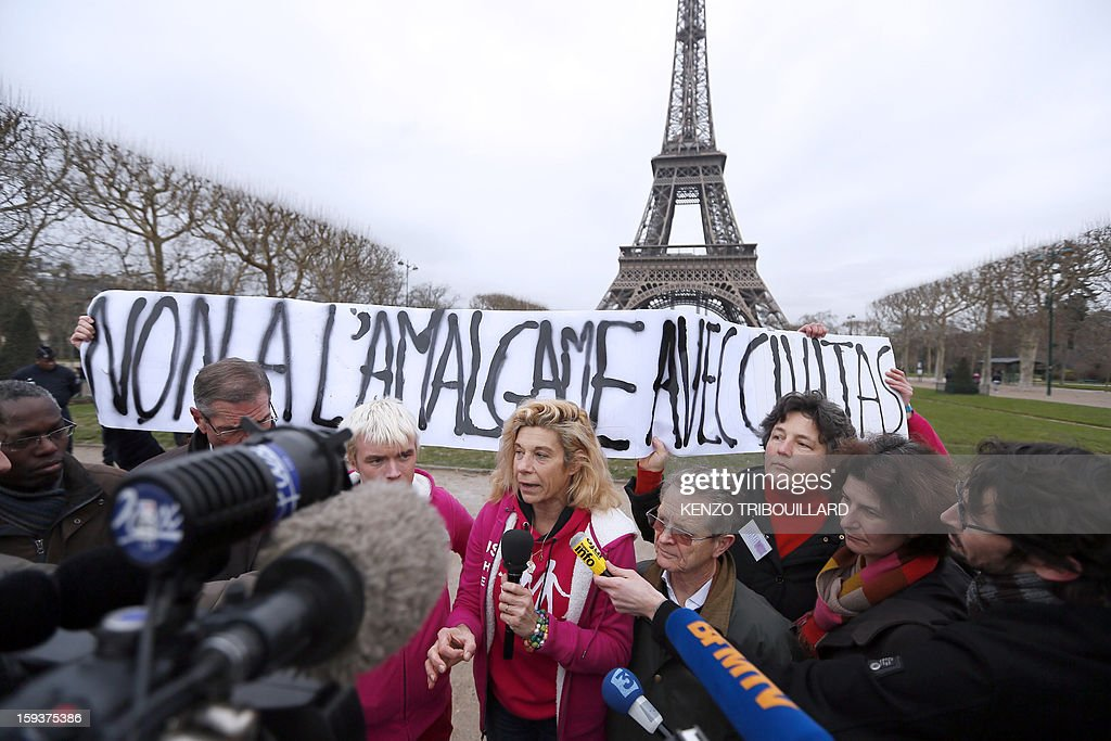 Virginie Tellene, known as 'Frigide Barjot', gives a press conference on January 12, 2013, at the Champs de Mars in front of the Eiffel Tower in Paris, on the eve of a national protest against same-sex marriage (Mariage pour tous). Banner reads : 'No to amalgam with Civitas' (a French catholic association).