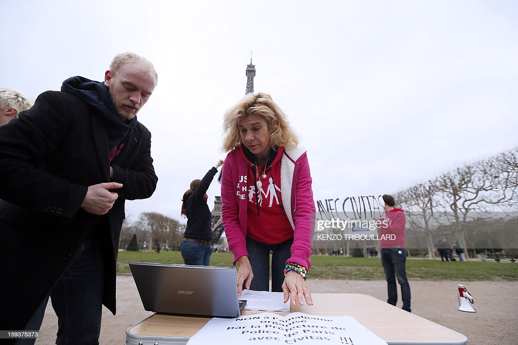Virginie Tellene, known as 'Frigide Barjot' looks at a computer, on January 12, 2013, at the Champs de Mars in front of the Eiffel Tower in Paris, on the eve of a national protest against the same-sex marriage (Mariage pour tous).