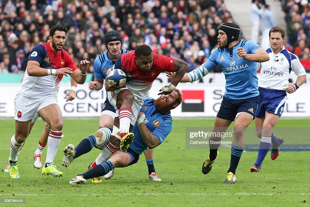 Virimi Vakatawa #11 of France breaks free from a tackle by Gonzalo Garcia #12 of Italy during the RBS Six Nations game between France and Italy at Stade de France on February 6, 2016 in Saint Denis near Paris, France.