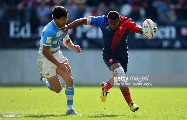 Virimi Vakatawa of France hands off Axel Muller Aranda of Argentina during the 3rd Place PlayOff match between France and Argentina on day three of...