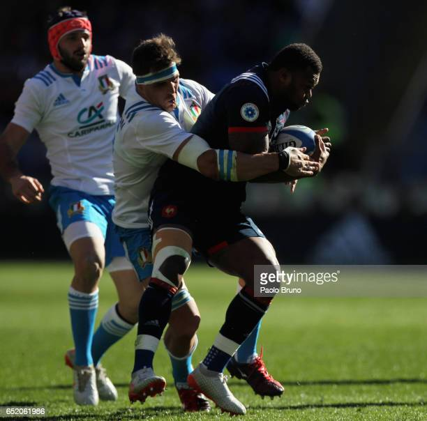 Virimi Vakatawa of France is tackled by Andries Van Schalkwyk of Italy during the RBS Six Nations match between Italy and France at Stadio Olimpico...