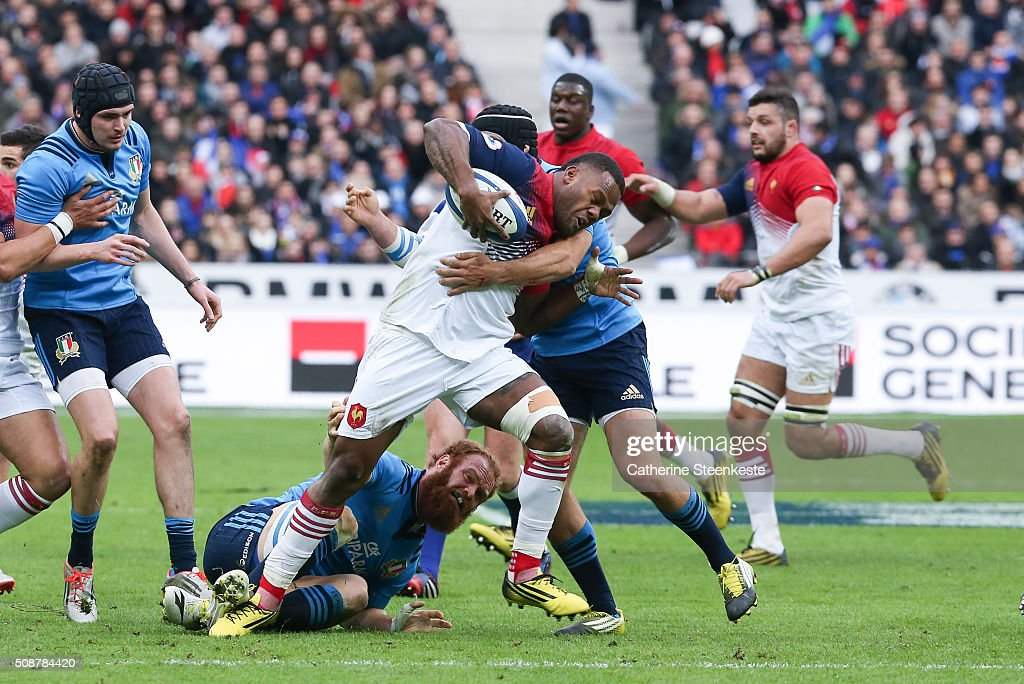 Virimi Vakatawa #11 of France is tackled by Edoardo Gori #9 of Italy during the RBS Six Nations game between France and Italy at Stade de France on February 6, 2016 in Saint Denis near Paris, France.