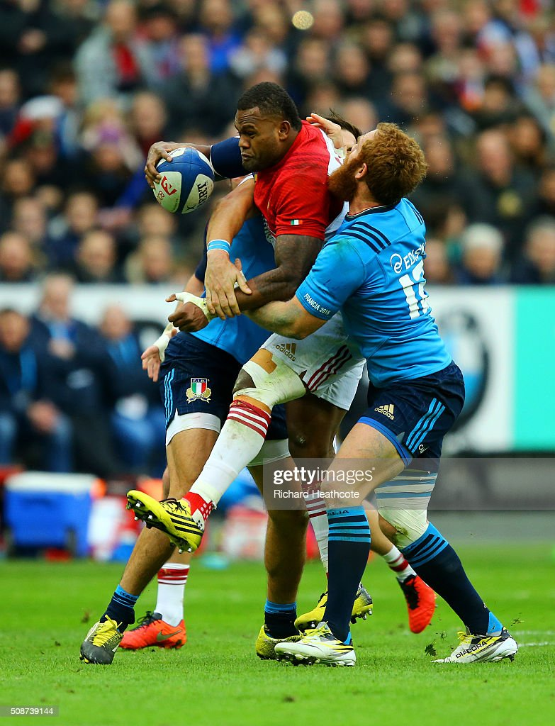 Virimi Vakatawa of France is tackled by Gonzalo Garcia of Italy during the RBS Six Nations match between France and Italy at Stade de France on February 6, 2016 in Paris, France.