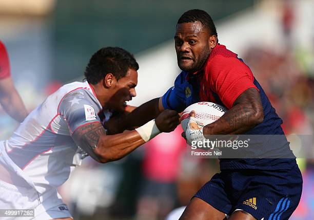 Virimi Vakatawa of France is tackled by Maka Unufe of the USA during the Emirates Dubai Rugby Sevens HSBC World Rugby Sevens Series on December 4...