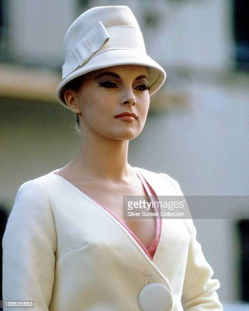 Virna Lisi Italian actress wearing a cream jacket with a matching cloche hat circa 1965