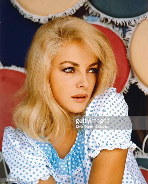 Virna Lisi Italian actress wearing a white top with blue polka dots with a blue collar with white polka dots posing looking to the right of the image...