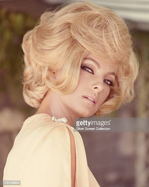 Virna Lisi Italian actress wearing a yellow top with slashed sleeves with a blonde bouffant hairstyle circa 1960