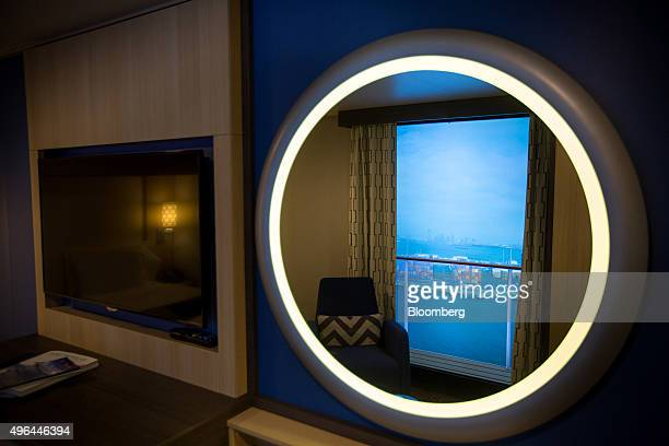 A virtual balcony view is reflected in a mirror in an interior stateroom of the Royal Caribbean Cruises Ltd Quantumclass cruise ship the Anthem of...