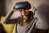 Zoung woman usig Virtual reality glasses