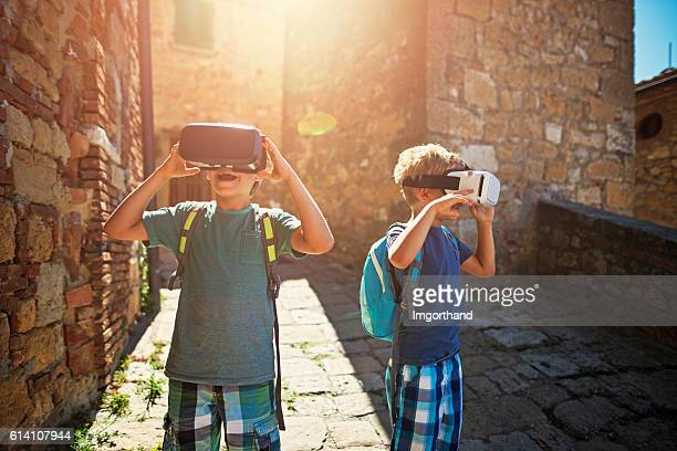 Virtual reality toursim - little boys visiting italian town