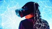Virtual reality game girl playing using vr glasses, graphic white lines and dots connected