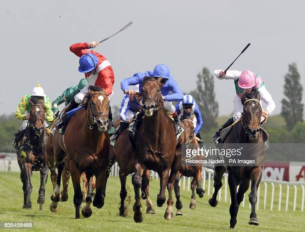 Virtual ridden by Jimmy Fortune goes on to win ahead of Alexandros ridden by Frankie Dettori and Twice Over ridden by Tom Queally in the Juddmonte...