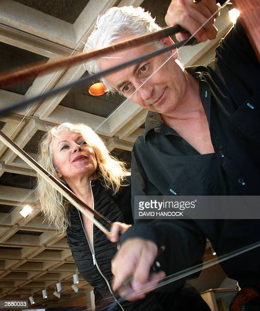 Virtuoso violinists Hollis Taylor and John Rose play music on a fence installed at the Art Gallery of New South Wales in Sydney 19 January 2004 The...