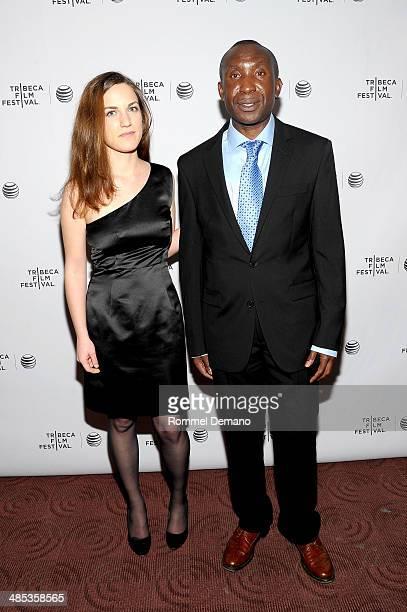 'Virunga' journalist Melanie Gouby and 'Virunga' subject and gorilla caretaker Andre Bauma attend the 'Virunga' Premiere during the 2014 Tribeca Film...