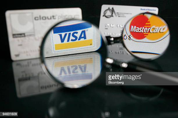 Visa and MasterCard credit cards are arranged for an illustration in Cambridge Massachusetts on Wednesday October 11 2006 Visa Inc the largest...