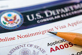 Online non-immigration visa application form with a pencil