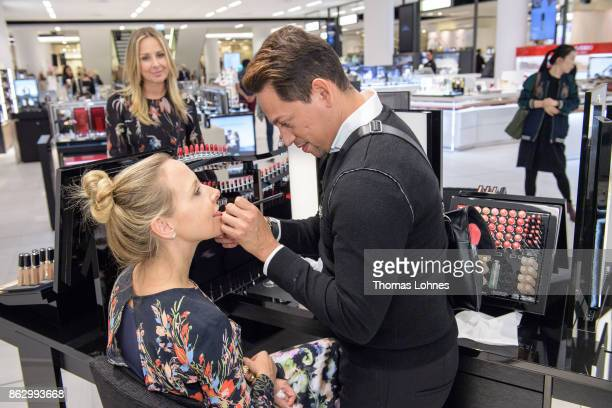 A visagist makes Daniela von CiesewskiWeinbach area manager Acqua Di Parma up during the pre opening of the Kaufhof Beauty World Opening while her...