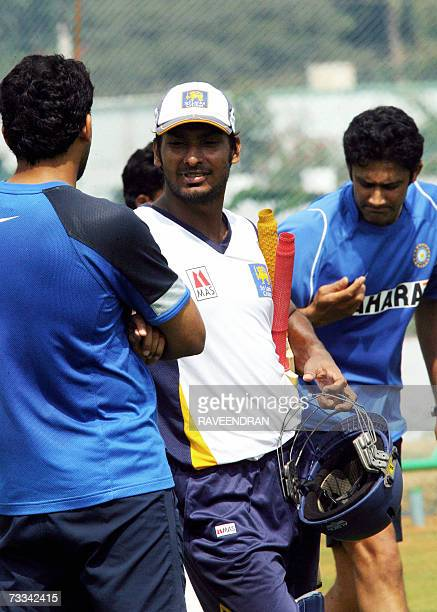 Sri Lankan cricketer Kumar Sangakkara talks with Indian players Zaheer Khan and Anil Kumble during a training session at the Andhra Cricket...