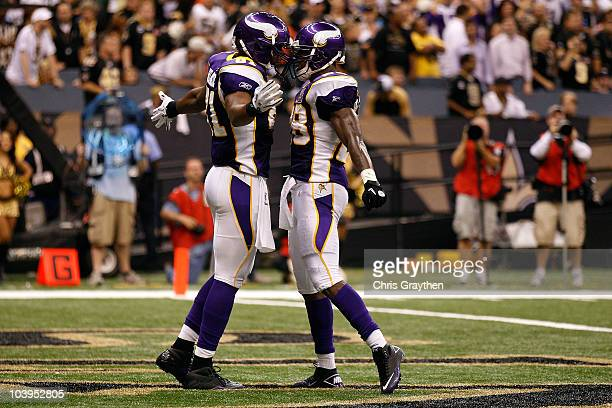 Visanthe Shiancoe and Adrian Peterson of the Minnesota Vikings celebrate after Shiancoe scored a 20yard touchdown reception in the second quarter...