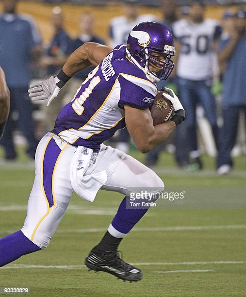 Visanthe Shiancoe of the Minnesota Vikings carries the ball during an NFL game against the Seattle Seahawks at the Mall of America Field at Hubert H...