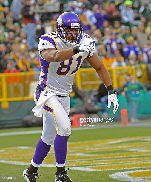 Visanthe Shiancoe of the Minnesota Vikings celebrates a touchdown during an NFL game against the Green Bay Packers at Lambeau Field on November 1...