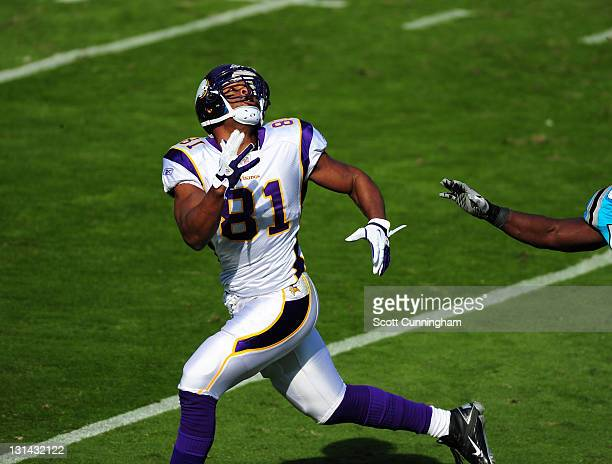 Visanthe Shiancoe of the Minnesota Vikings goes up for a pass against the Carolina Panthers at Bank of America Stadium on October 30 2011 in...