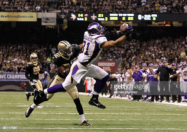 Visanthe Shiancoe of the Minnesota Vikings makes a one handed catch against Tracy Porter of the New Orleans Saints during the NFC Championship Game...