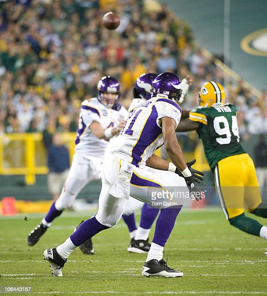 Visanthe Shiancoe of the Minnesota Vikings waits for the ball during a NFL game against the Green Bay Packers at Lambeau Field on October 23 2010 in...