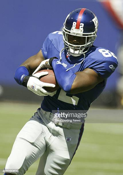 Visanthe Shiancoe of the New York Giants runs with the ball during warmups before a game against the St Louis Rams on September 07 2003 at Giants...
