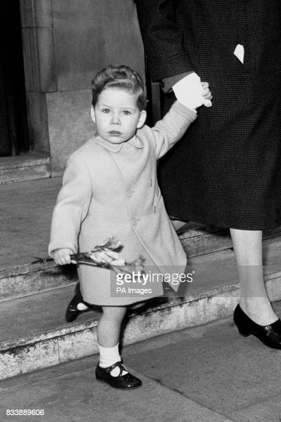 Viscount Linley clutching a handful of flowers leaves the King Edward VII Hospital for Officers in Marylebone London after visiting the Queen Mother...